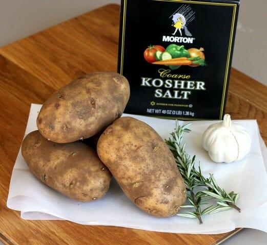 baked potatoes, rosemary, garlic, and salt