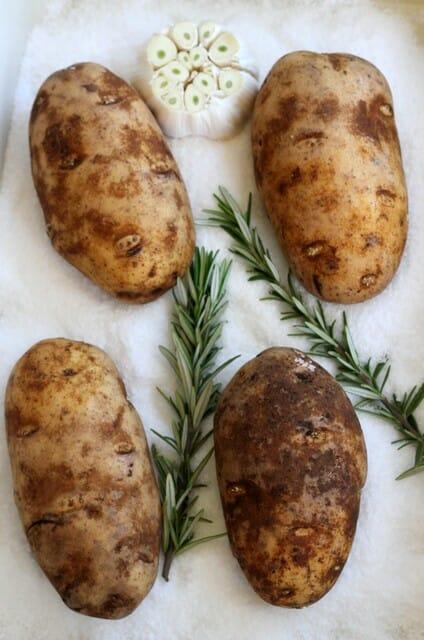 potatoes, rosemary, and garlic in salt