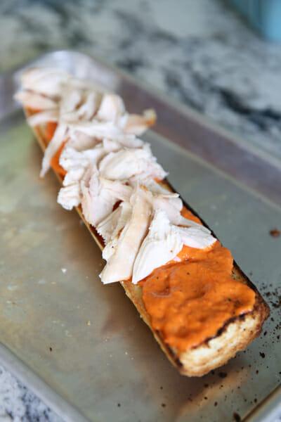 Layering Chicken on Sandwich