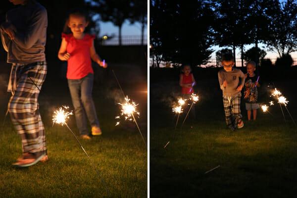 kids running through sparklers