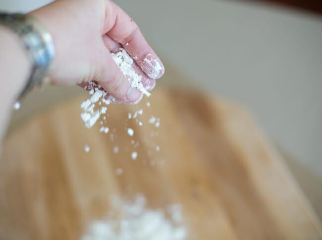 sprinkling peel with flour