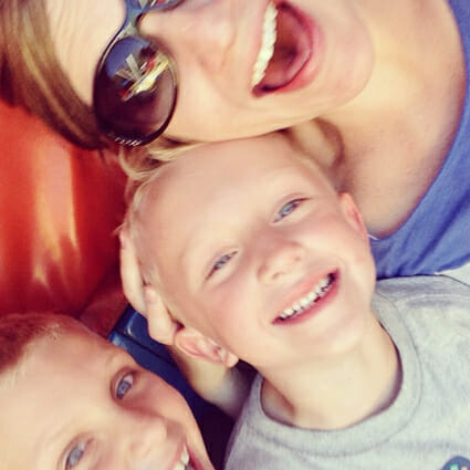 Me with a couple of my kiddos on a tilt-a-whirl mid-ride!