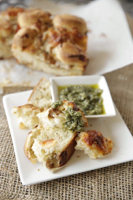 Baked Cheesy Pizza Bread with Pesto from Our Best Bites