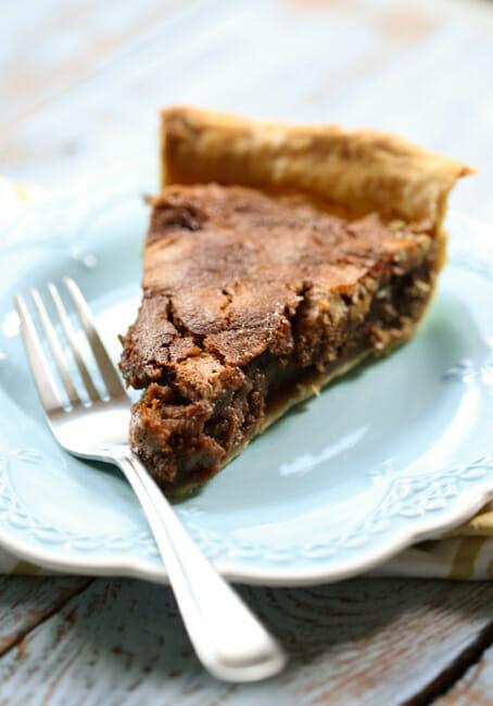slice of caramel chocolate pecan pie on a plate
